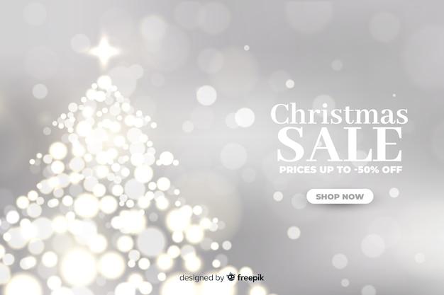 Weihnachtsverkaufskonzept mit unscharfem hintergrund Kostenlosen Vektoren