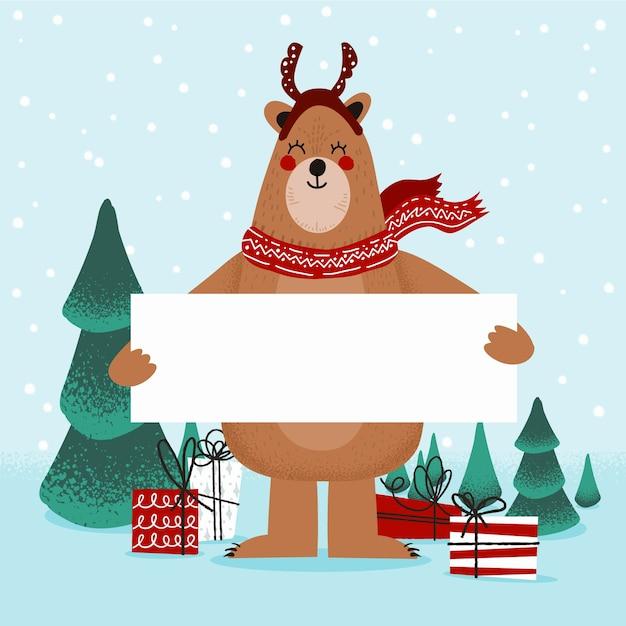 Weihnachtszeichenbär, der unbelegte fahne anhält Kostenlosen Vektoren