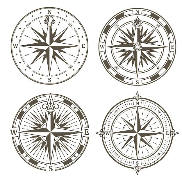 Weinlese nautischer kompasszeichen-vektorsatz Premium Vektoren