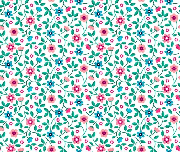 Weinleseblumenhintergrund. nahtloses muster für design- und modedrucke. blumenmuster mit kleinen blauen und rosa blumen auf einem weißen hintergrund. ditsy stil. Premium Vektoren