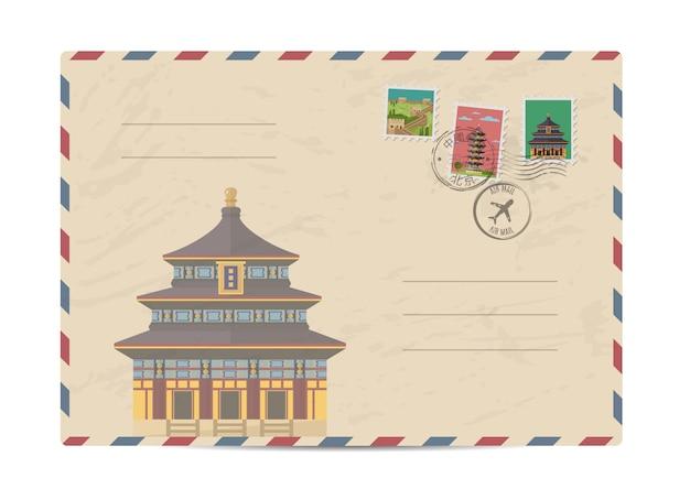 Weinlesepostumschlag mit china-briefmarken Premium Vektoren