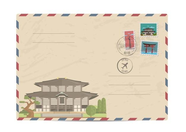 Weinlesepostumschlag mit japan-briefmarken Premium Vektoren