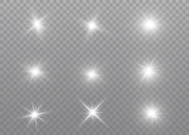 Weiß leuchtendes licht explodiert. funkelnde magische staubpartikel. heller stern. transparent strahlende sonne, heller blitz. Premium Vektoren