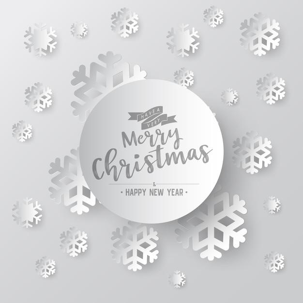 Weißbuchschneeflocke auf weißem aufwändigem hintergrund mit phasentext der frohen weihnachten Premium Vektoren