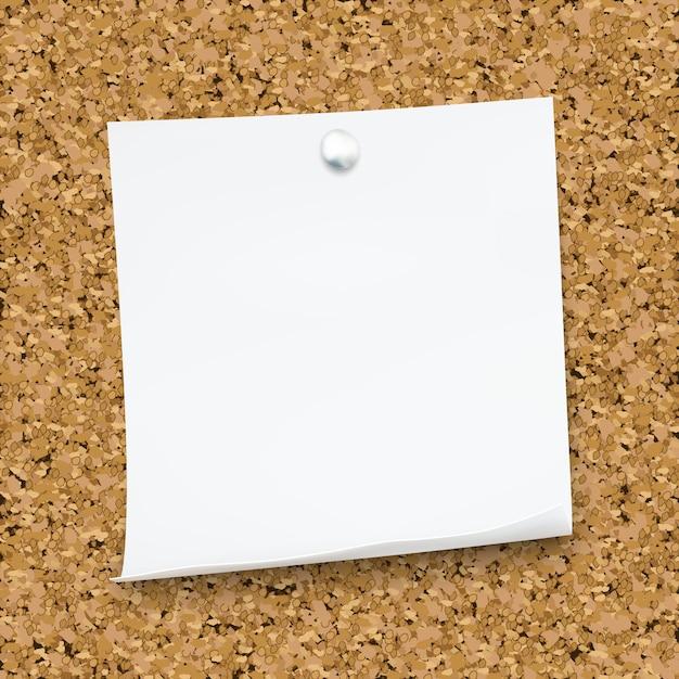 Weiße haftnotiz lokalisiert auf dem korkenbrett Premium Vektoren