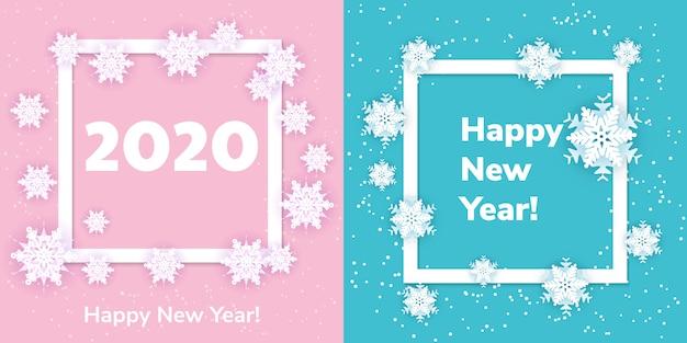 Weiße origamischneeflocken mit schatten auf blau und rosa. papierschnitt. set quadratischen rahmens. winter illustration zum dekorieren für das neue jahr 2020 und weihnachten. Premium Vektoren