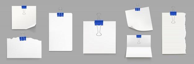 Weiße papierbögen mit blauen binderclips Kostenlosen Vektoren