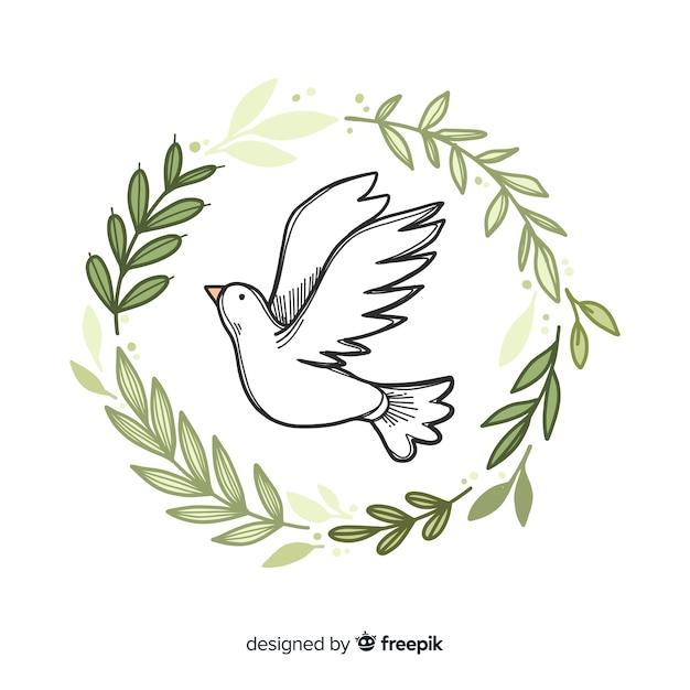 Weltfriedenstaghintergrund mit gezeichneter art der taube in der hand Kostenlosen Vektoren
