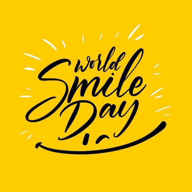 Weltlächeltagbeschriftung mit glücklichem gesicht Kostenlosen Vektoren