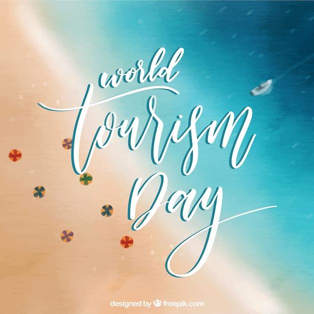 Welttourismus tag mit unscharfen strand Kostenlosen Vektoren