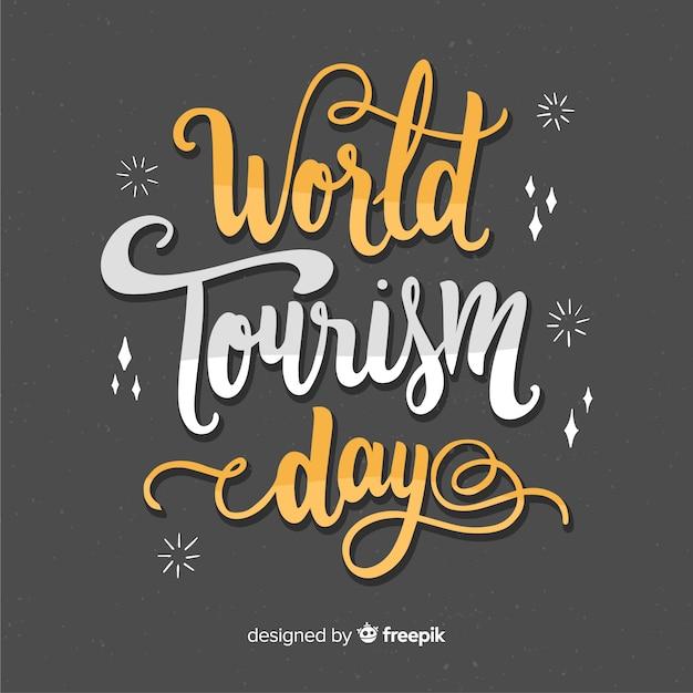 Welttourismus-tagesbeschriftung mit flachem design Kostenlosen Vektoren