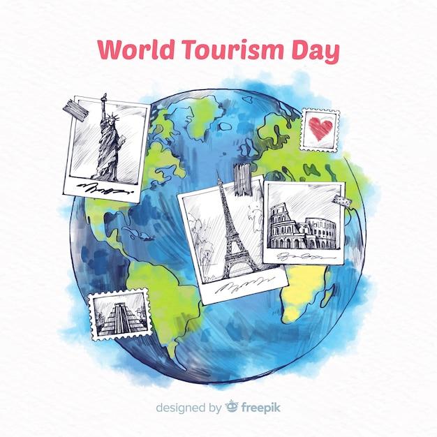 Welttourismustageshintergrund mit gezeichneten art der monumente in der hand Kostenlosen Vektoren