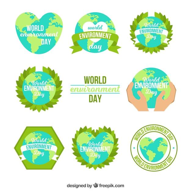 Weltumwelt-Etikettensammlung mit Erdkugelform Kostenlose Vektoren