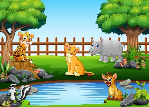 Wilde tiere spielen am rande eines schönen kleinen teiches Premium Vektoren
