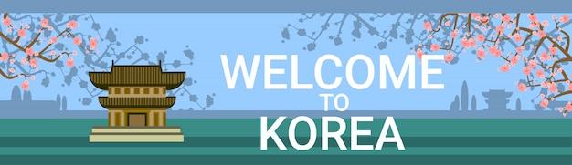Willkommen in korea mit traditionellen tempel oder palast über blühenden sakura tree hintergrund Premium Vektoren