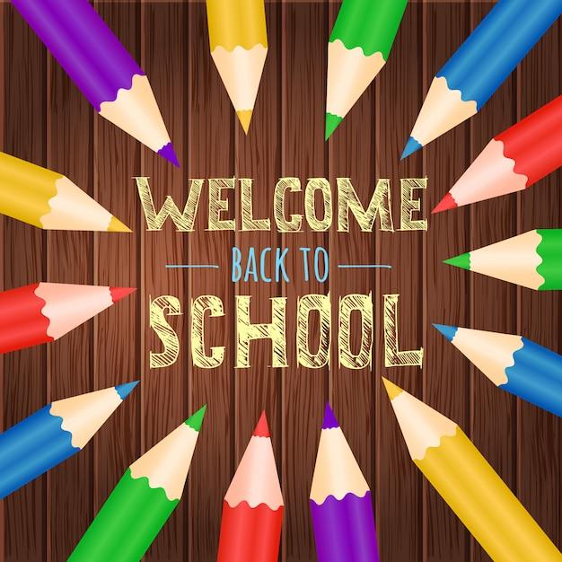 Willkommen zurück in der schule mit buntem bleistiftholzhintergrund Premium Vektoren