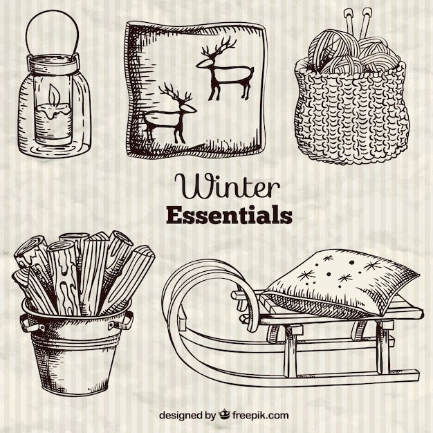 Winter wesentliche in hand gezeichnet stil Kostenlosen Vektoren
