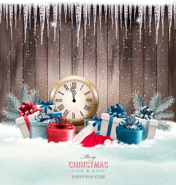 Winterhintergrund mit geschenken und uhr Premium Vektoren