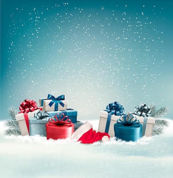 Winterhintergrund mit geschenken. Premium Vektoren