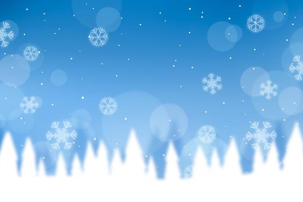 Winterkonzept mit unscharfem hintergrund Kostenlosen Vektoren