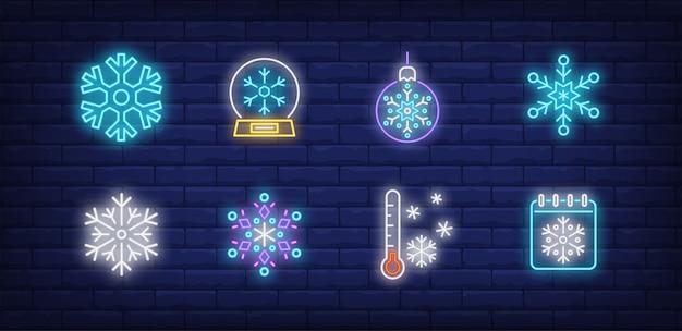 Wintersymbole im neonstil mit schneeflocken Kostenlosen Vektoren