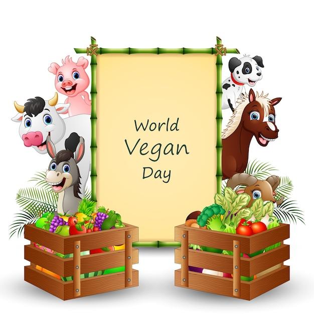 World vegan day text auf schild mit gemüse und nutztieren Premium Vektoren