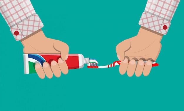 zahnbürste zahnpasta in der hand zähne putzen  premium