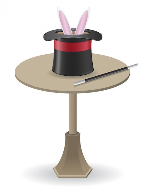 Zauberstab und zylinderhut auf dem tisch. Premium Vektoren