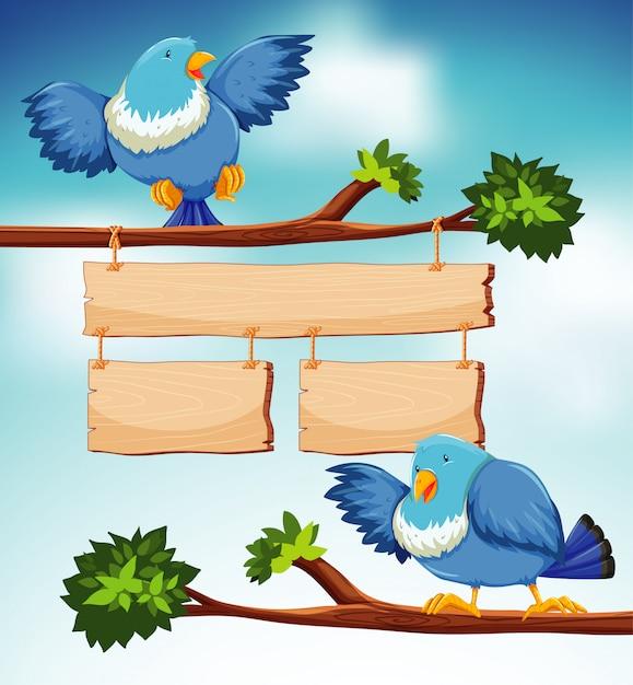 Zeichenvorlage mit zwei blauen vögeln auf dem zweig Kostenlosen Vektoren