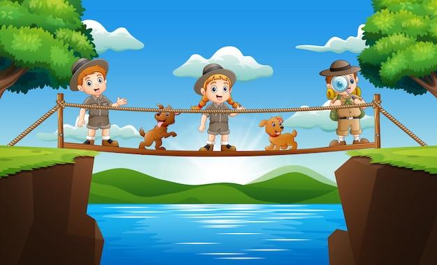 Zookeeper drei, der auf einer holzbrücke steht Premium Vektoren