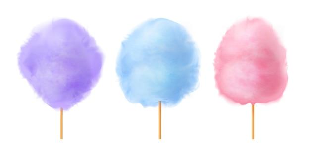 Zuckerwatte-set. realistische blaue purpurrote rosa zuckerwatte auf hölzernen stöcken. Premium Vektoren