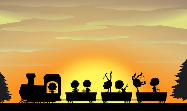 Zug silhouette bei sonnenuntergang Kostenlosen Vektoren