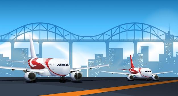 Zwei flugzeuge parken auf der piste Kostenlosen Vektoren