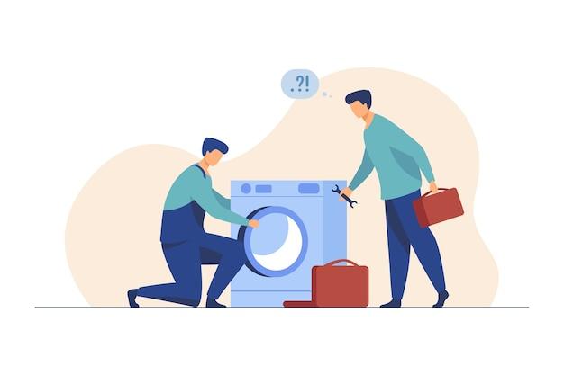 Zwei handwerker reparieren die waschmaschine. handwerker, mentor und praktikant mit werkzeugen flache illustration Kostenlosen Vektoren