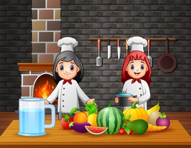 Zwei köche bereiten am esstisch essen zu Premium Vektoren