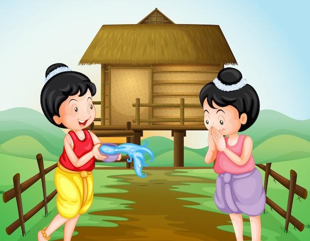 Zwei thailändische mädchen am wasserfestivaltag Premium Vektoren