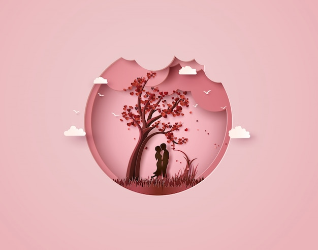 Zwei verliebt unter einem liebesbaum Premium Vektoren