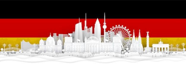 A bandeira de alemanha e os marcos famosos no papel cortaram a ilustração do vetor do estilo. Vetor Premium