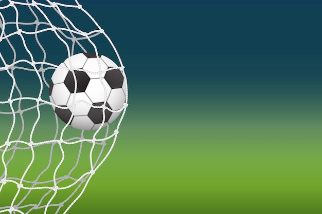 A bola de futebol entra no gol. Vetor Premium