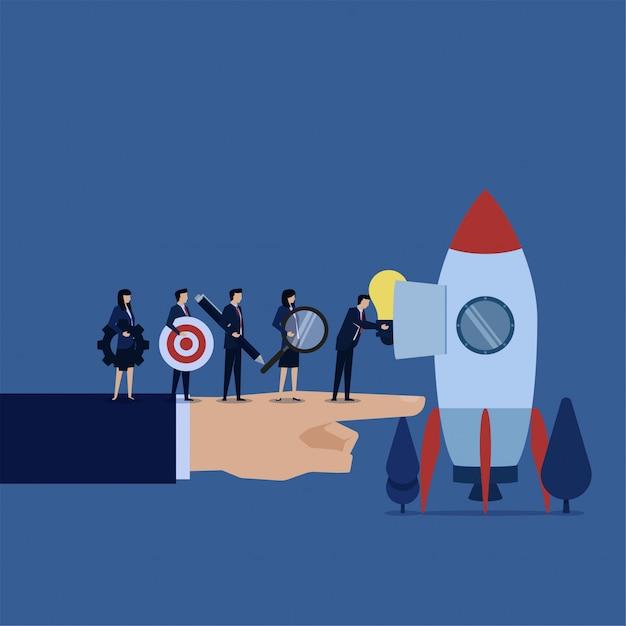 A equipe do negócio pôs a ideia amplia o alvo e a engrenagem na metáfora do foguete de prepara o começo. Vetor Premium