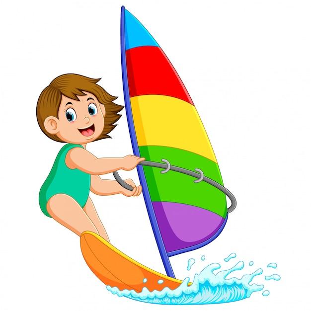 A garota profissional está em pé barco à vela Vetor Premium