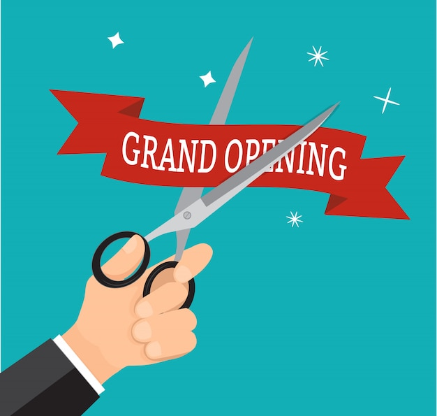 A grande inauguração vermelha da fita do corte do negócio da mão com scissor. Vetor Premium
