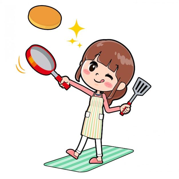 A linha avental da mãe cozinhe o hotcake Vetor Premium