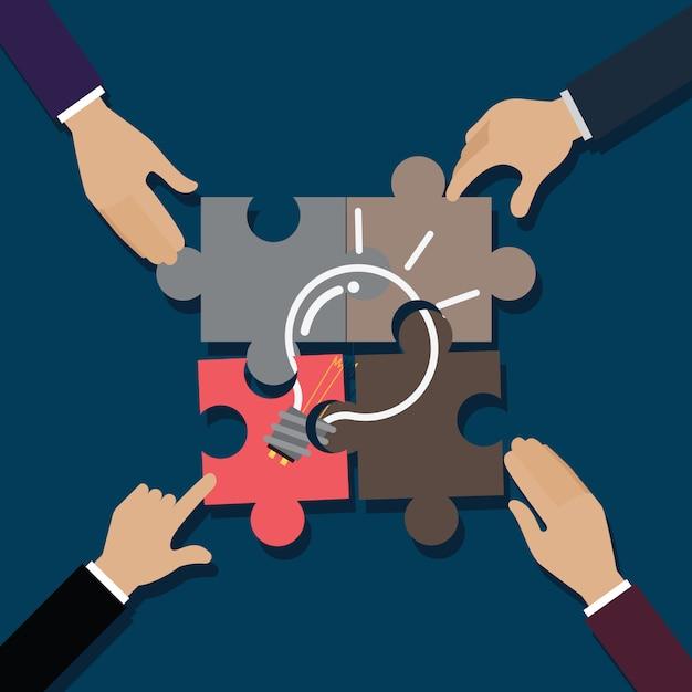 A mão de um negócio é quebra-cabeça quebra-cabeça Vetor Premium