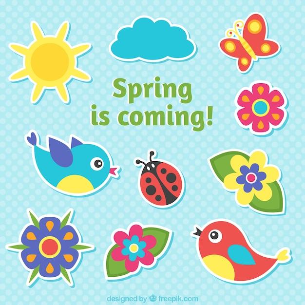 A primavera está chegando rótulos Vetor grátis