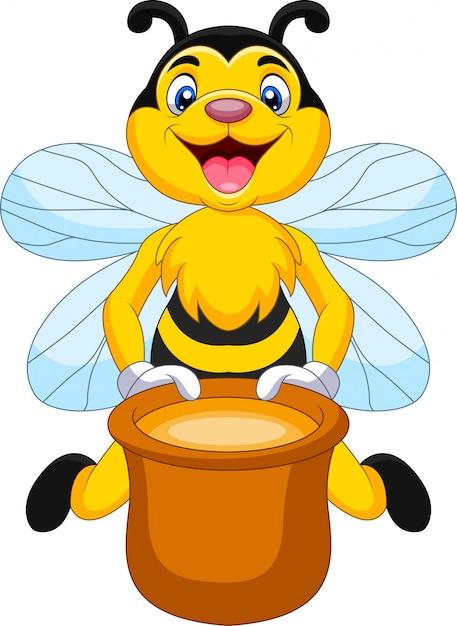 Abelha de desenho animado com pote de mel Vetor Premium