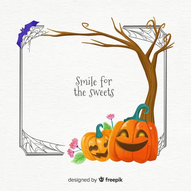 Abóboras sob um quadro de halloween de árvore Vetor grátis