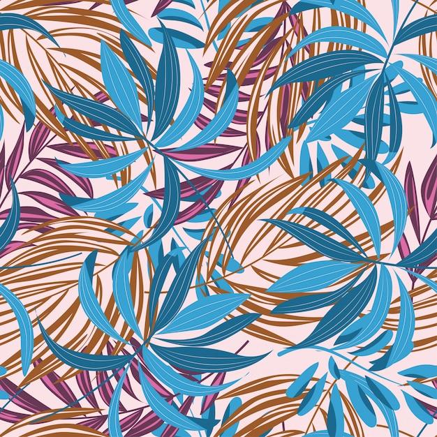 Abstrata sem costura padrão com folhas tropicais coloridas e plantas em branco Vetor Premium