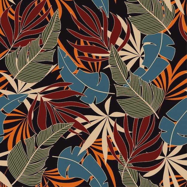 Abstrata sem costura padrão tropical com plantas e folhas azuis e vermelhas brilhantes Vetor Premium
