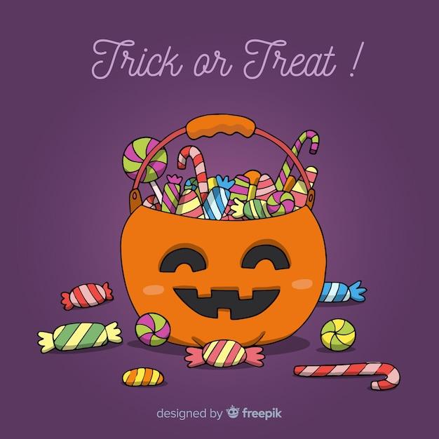 Adorável mão desenhada saco de doces de halloween Vetor grátis